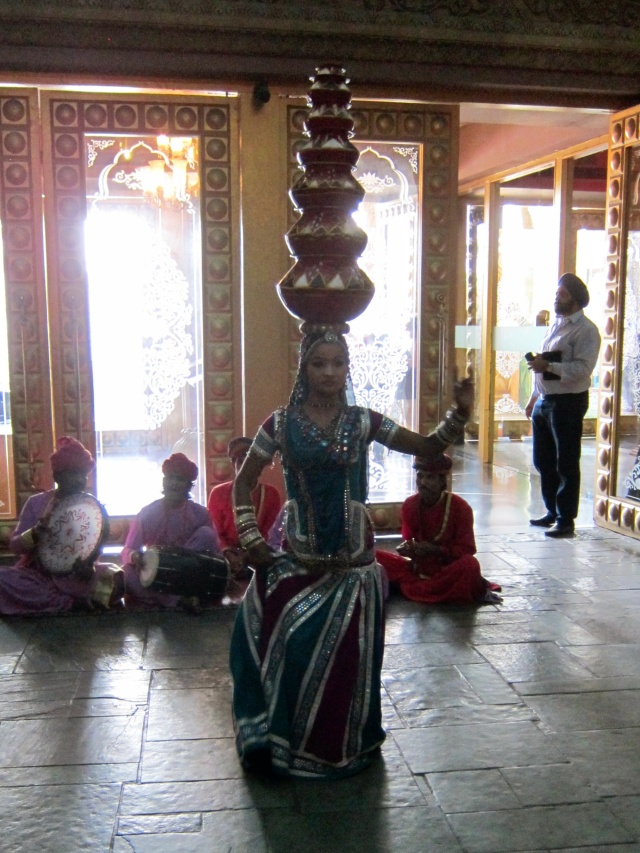 Dancing girl with pots on her head